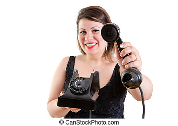Friendly smiling woman holding out a telephone - Friendly...