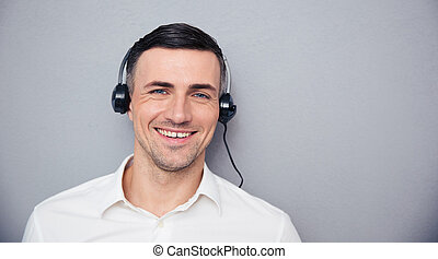 Portrait of a smiling male assistant looking at camera
