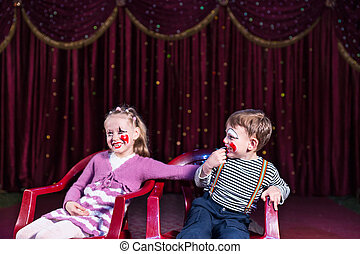 Young Clowns Sitting and Laughing on Stage - Girl and Boy...