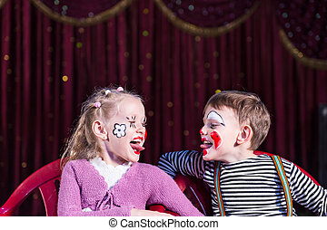 Young Clowns Sticking Tongues Out at Each Other - Boy and...