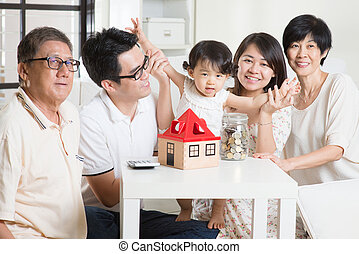 Asian family financial concept - Family money saving or...