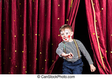 Happy little boy actor making his entrance onto the stage...