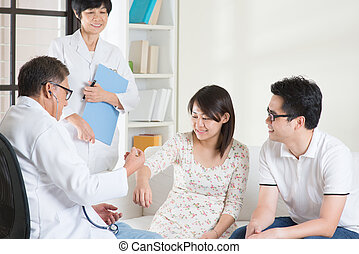 Gynecology - Asian couple consult doctor. Woman health...