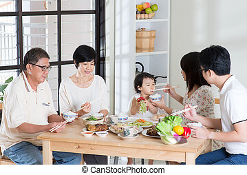 Family eating at home - Asian family eating at home. Multi...
