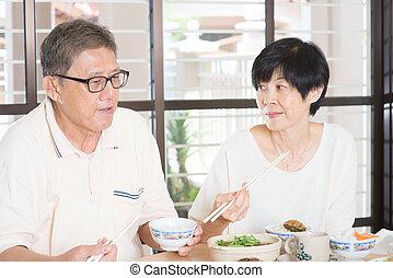 Senior couple having meal - Asian Senior couple having meal...
