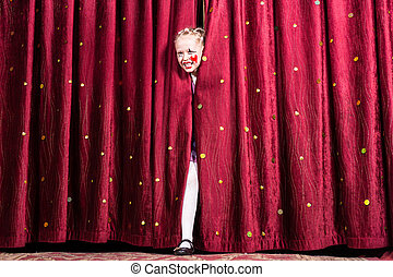 Laughing young girl making her entry on stage - Laughing...