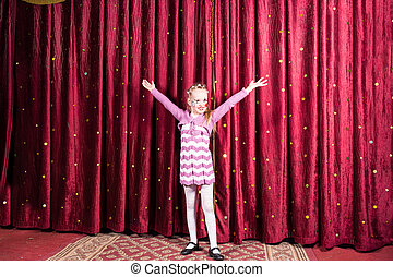 Little girl standing on stage during a performance - Pretty...