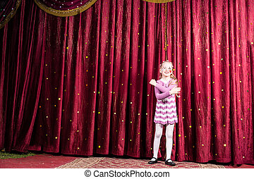 Blond Girl Wearing Clown Make Up Standing on Stage - Full...