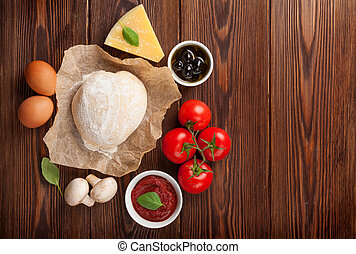 Pizza cooking ingredients. Dough, vegetables and spices. Top...