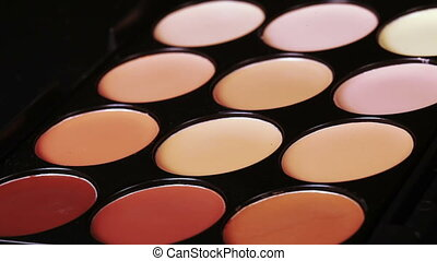 Cosmetic concealer - Rotating colored eye shadow palette for...