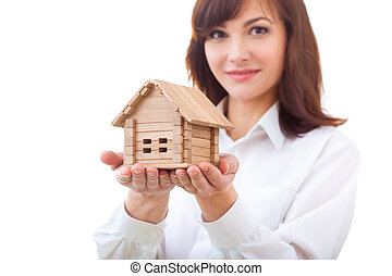 adult realtor with wooden toy house,it could be the tenant...