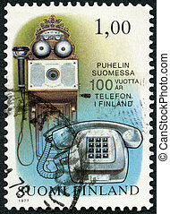 FINLAND - 1977: shows wall telephone 1880 and new telephone...