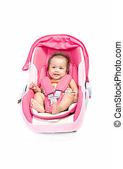 Cute baby in a car seat, isolated on white