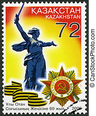 """KAZAKHSTAN - 2005: shows the sculpture """"Motherland"""" and the Order of the Patriotic War, End of World War II, 60th"""