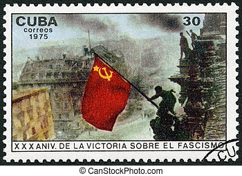 CUBA - 1975: shows Raising red flag over Reichstag, Berlin,...