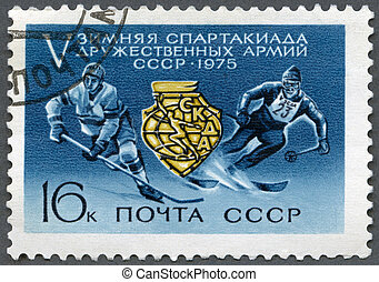 USSR - 1975: shows Games Emblem Ice Hockey Player and Skier,...