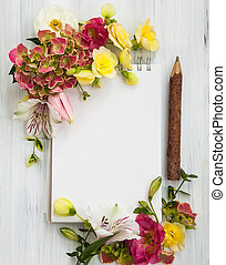 Flowers and notepad - Blank notepad,pen and flowers over...