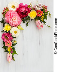 Flowers frame on white wooden background. Top view with copy...