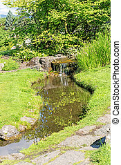 Decorative pond with waterfall at Oslo city park -...