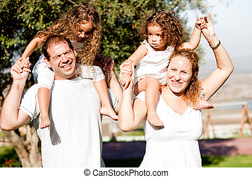 Happy family having fun in the park
