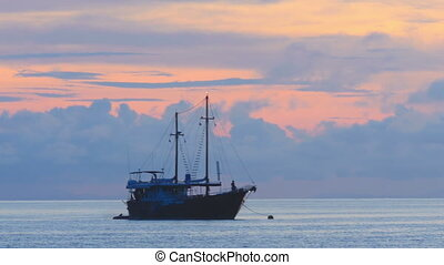 Sailboat at anchor - Two-masted sailing ship at anchor off...