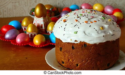 Easter cake smeared with cream, sprinkle with colored sugar