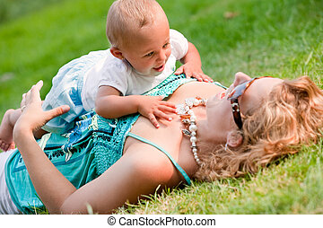 Crawling on mothers chest - The family and a happy babys...