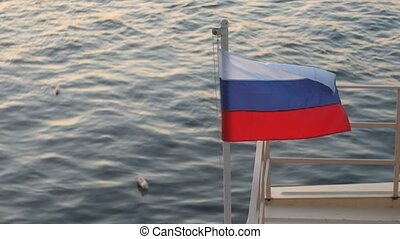 Russian flag flying in the wind