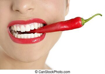 Beautiful woman teeth eating red pepper - Beautiful woman...