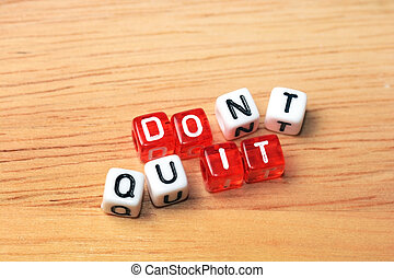 Do It - Dont Quit Do It written on red and white dices on...