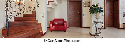 Corridor with elegant stairs and armchair - Classy house -...