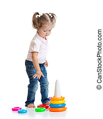 child toddler playing with pyramid toy