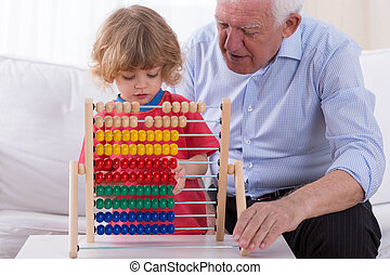 Kid playing with abacus toy
