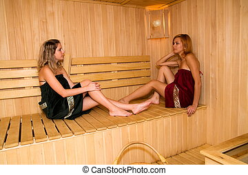Girls in a sauna - The girls relax in the sauna of his hotel...
