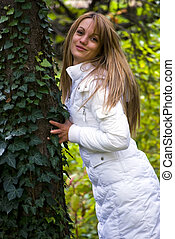 autumn - cute girl leaning against autumn tree