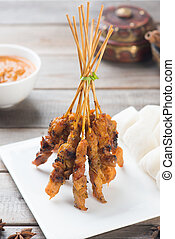 delicious malaysian satay with curry sauce
