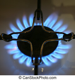 natural gas - brightly burning natural gas on kitchen