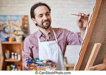 Painting on canvas - Male artist painting on canvas
