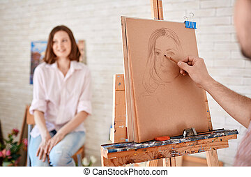 Drawing muse - Hand of male artist drawing young woman on...