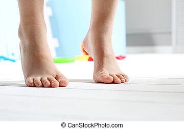 Children's bare feet - Child's bare feet on the wooden floor...
