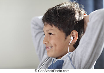 Young boy with headphones watching computer