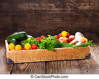 vegetables and herbs in wooden box