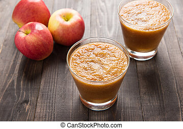 Flash red apples smoothie on Wooden background