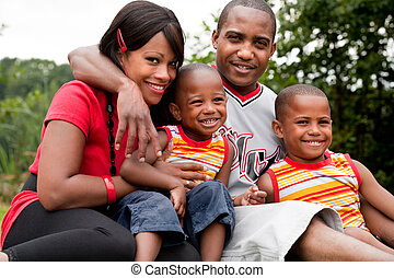 Colorfull african family - Happy black family enjoying their...