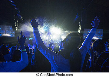 Female At Rock Concert - Anonymous Woman with Arms Up in...