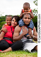 Standard family portrait - Happy black family enjoying their...