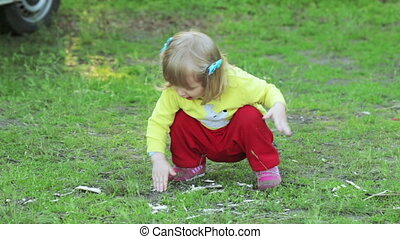 Girl in garden - Little girl playing in park with land