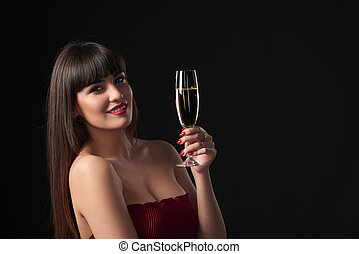 Woman celebrating - Sensual smiling woman holding a glass...