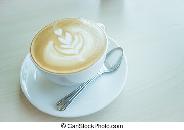 Hot cup of coffee latte, stock photo