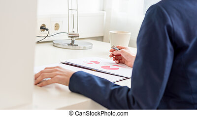 Business woman analyzing printed important data